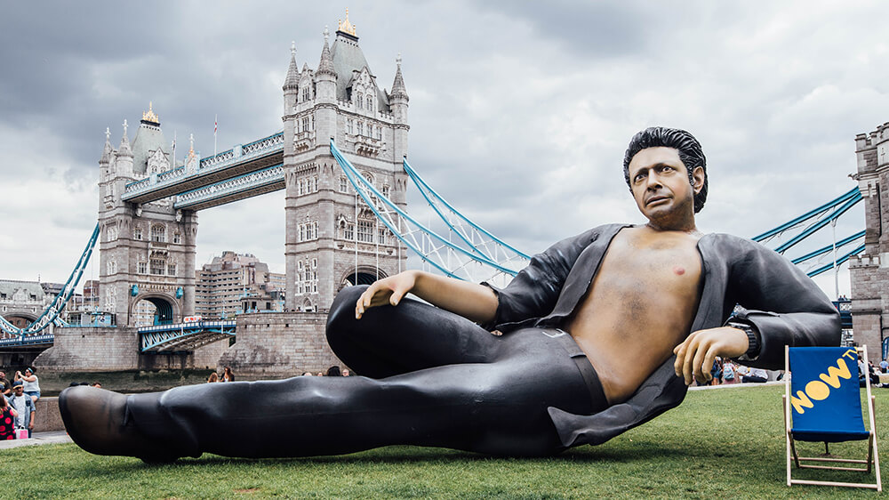 A 25 Foot Ian Malcolm 'Jurassic Park' Statue Has Taken Over London